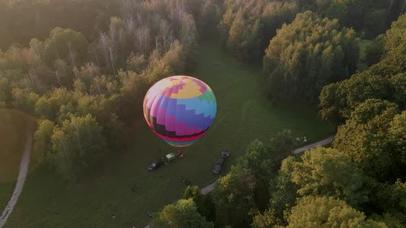Aerial View of Colorful Hot Air Balloon Prepare for an Summer Early Morning Flying in Park in Small