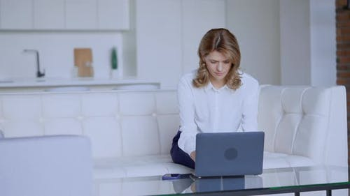Female Using Computer in Flat