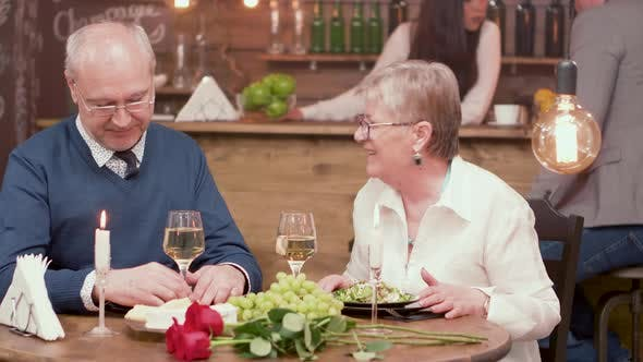 Cover Image for Cheerful Senior Couple on a Romantic Date in a Restaurant
