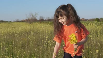 The child collects flowers in the spring.