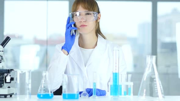 Thumbnail for Female Scientist Talking on Phone in Laboratory