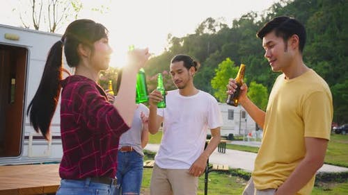 Group of Asian man and woman are having new year party outdoor in the evening together.