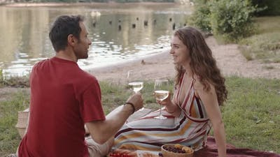 Couple Drinking Wine by Pond