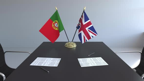 Flags of Portugal and the United Kingdom and Papers