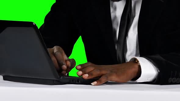 Thumbnail for Young Businessman Working on His Laptop at His Desk. Green Screen