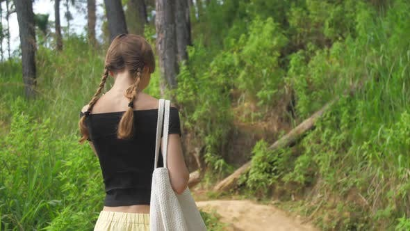 Thumbnail for Slim Girl Walks Along Highland Path Surrounded By Trees
