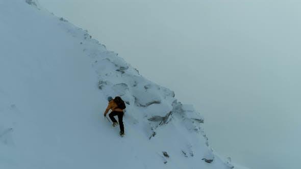 Mountain Climber on a Steep Snowy Ascent