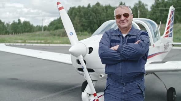 Thumbnail for Mature Pilot Proud of his Plane