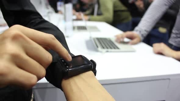 Thumbnail for Girl Using Smart Watch In A Public Place