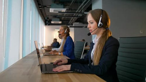 Call Center Business Woman Have Conversation with Customers and Looking at Camera