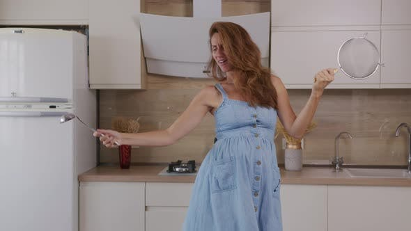 Thumbnail for Joy and Fun Pregnant Mother Active Dancing in Home and Preparing Eat. Happy Emotions Young Mother
