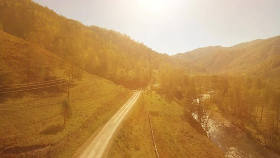 Cover Image for Low Altitude Flight Over Fresh Fast Mountain River with Rocks at Sunny Summer Morning.