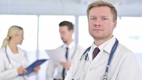 Cover Image for Portrait of Serious Male Doctor Saying No By Finger Sign