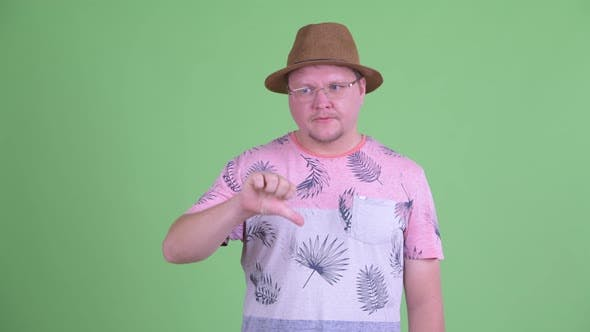 Cover Image for Angry Overweight Bearded Tourist Man Giving Thumbs Down