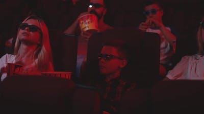 Boy Watching Comedy Movie in Cinema
