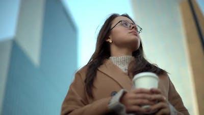 Slow Motion Lowangle Attractive Brunette Urban Woman Wearing Glasses Beige Coat Holding Takeaway