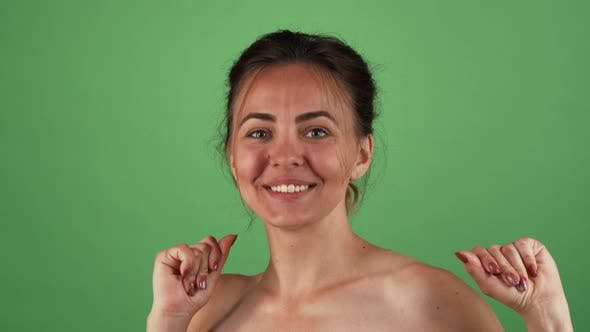 Thumbnail for Young Beautiful Woman Looking Excited Posing on Green Background