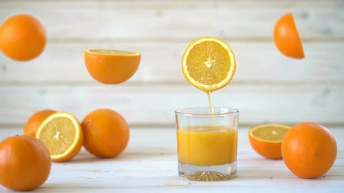 Cinemagraph - Pouring the Orange Juice Into a Glass.