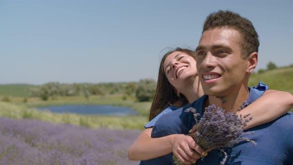 Thumbnail for Portrait of Multietnic Couple Rejoicing Outdoors