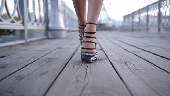 Thumbnail for Closeup Sexy Feet in High Heels Walking on Bridge