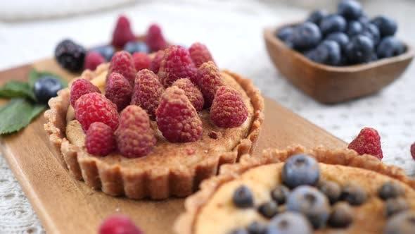 Cooking Vegan Tart With Fresh Raspberries And Blueberries
