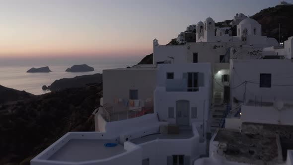 Thumbnail for Aerial View of Little Village on Milos Island, Greece After Sunset with Ocean View