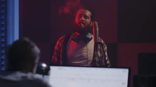 Vocalist Smoking in Studio