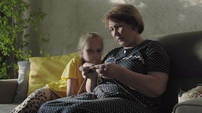 Grandma Knitting With Child