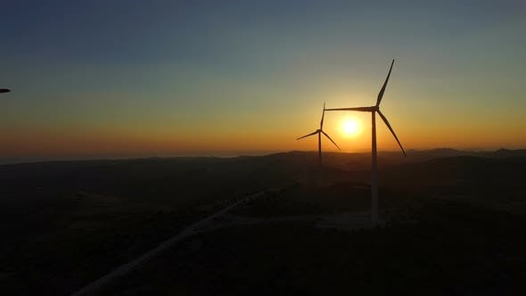Thumbnail for Flying close to windmill blades at dusk