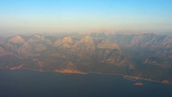 Thumbnail for Breathtaking View of Towering Mountains and High Rocks From Airplane, Flight