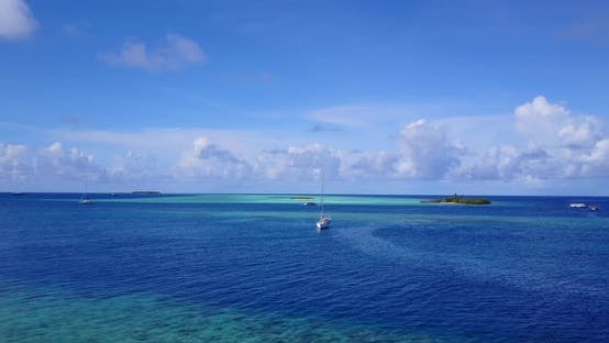 Thumbnail for Beautiful fly over island view of a white sandy paradise beach and aqua blue water background in vib