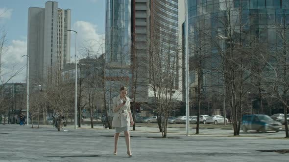 Cover Image for Businesswoman Walking with Smartphone