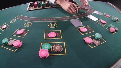 Casino Dealer Shuffles the Cards. Slow Motion. Close Up