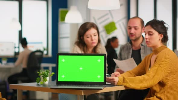 Thumbnail for Group of Business People Discussing Company Plan with Mockup Laptop