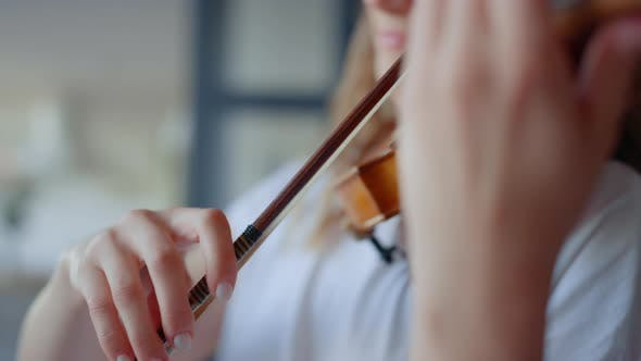 Thumbnail for Musician Playing Violin with Bow. Girl Creating Music on String Instrument