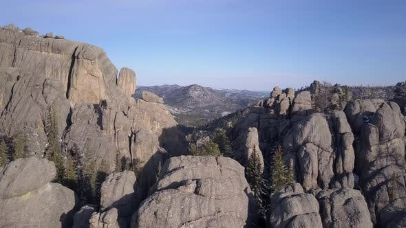 Thumbnail for Dramatic Drone Flyover of Mountain Scenery with Lake and Granite Rocks Geology Outcroppings