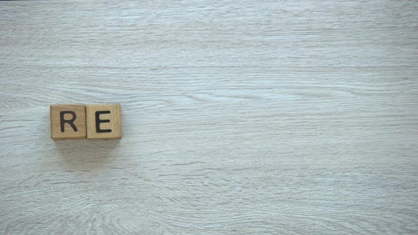Thumbnail for Recycling Hand Putting Word on Wooden Cubes