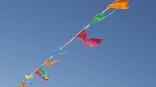 Many flags on the wind wayving beach decoration close-up 2160p 30fps UltraHD footage - Multicolor pe