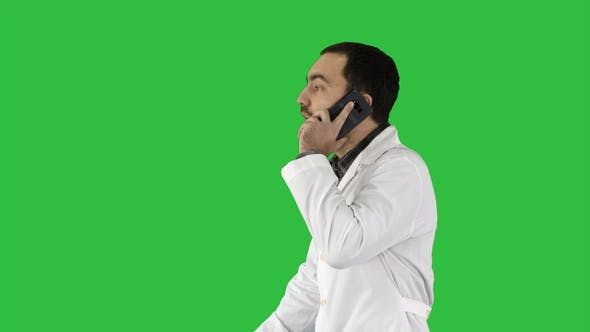 Thumbnail for Doctor talking on mobile phone on a Green Screen, Chroma Key.