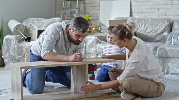 Thumbnail for Family Assembling Furniture in New House