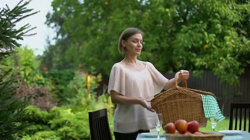 Happy Couple Preparing for Picnic in Country House, Healthy Food, Well-Being