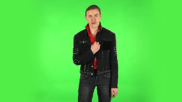 Thumbnail for Guy Talks About Something Then Making a Hush Gesture, Secret. Green Screen