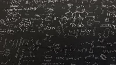 White structural formulae of chemical compounds on blackboard