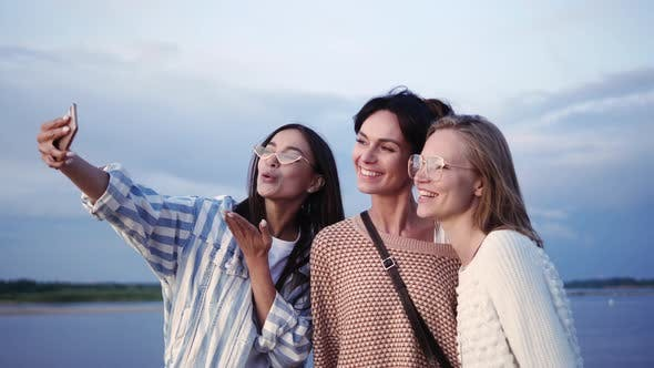 Thumbnail for Group of Happy Female Friends Laughing and Taking a Selfie.