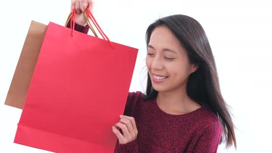 Thumbnail for Excited woman holding shopping bag