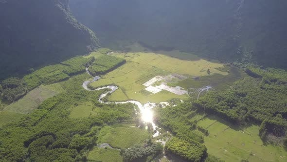 Valley Fields Crossed By Winding River on Day Upper View