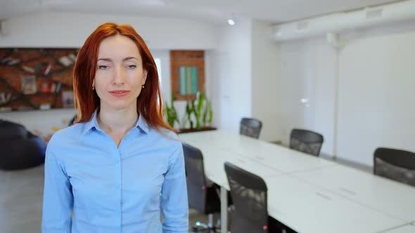 Employer Posing at Workspace