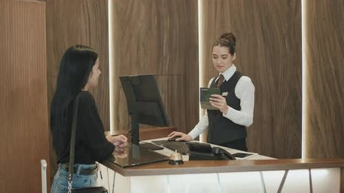 Lady Checking-In at Hotel