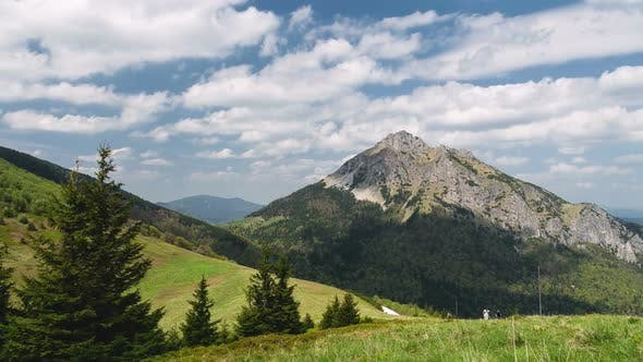 Thumbnail for Hiking in Alpine Mountains Nature in Sunny Summer with White Clouds on Blue Sky Landscape