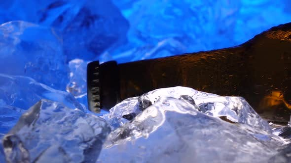 Thumbnail for Bottle of Beer in the Ice, Like Crystals, Drops of Condensate Fall Down the Glass